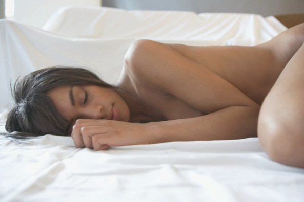Young Nude Woman Lying in Bed