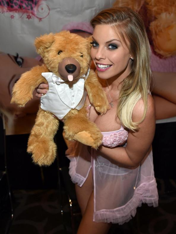 Britney Amber displays new Teddy Love Bear toy that features vibrating nose and tongue