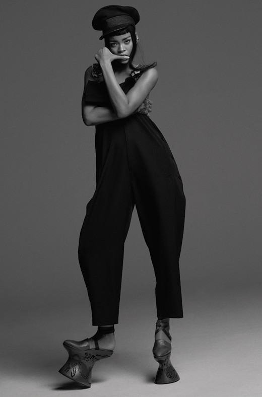 Rihanna wears dungarees and wool cap by Yohji Yamamoto; grosgrain ribbon (laced around legs throughout)